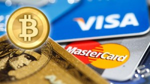 Image of a physical bitcoin and various credit cards.