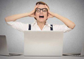 Woman panicking behind a laptop